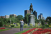 Massachusetts, Boston; Tourists Photograph George Washington Monument; Boston Common; City Skyline In Backgroun