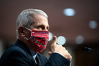 Anthony Fauci, director of the National Institute of Allergy and Infectious Diseases, gives a thumbs up during a Senate Health, Education, Labor and Pensions Committee hearing in Washington, D.C., U.S., on Tuesday, June 30, 2020. Top federal health officials are expected to discuss efforts to get back to work and school during the coronavirus pandemic. Credit: Al Drago/CNP/AdMedia