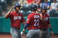 Lehigh Valley IronPigs Tommy Joseph (22) high fives Taylor Featherston (right) and Nick Williams (left) after a home run by Williams during a game against the Columbus Clippers on May 12, 2016 at Huntington Park in Columbus, Ohio.  Lehigh Valley defeated Columbus 2-1.  (Mike Janes/Four Seam Images)