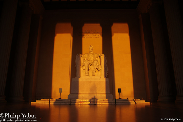 In March and September, the sun shines directly into the main chamber of the Lincoln Memorial, illuminating President Abraham Lincoln's statue in gold.