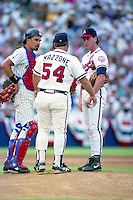San Diego Padres catcher Benito Santiago and Atlanta Braves pitcher Tom Glavine listen to pitching coach Leo Mazzone (54) during the Major League Baseball All-Star Game at Jack Murphy Stadium  in San Diego, California.  (MJA/Four Seam Images)