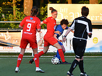 Hanna Mylee (29) of Woluwe and Lotte Van Den Steen (15) of KRC Genk battle for the ball during a female soccer game between  Racing Genk Ladies and White Star Woluwe on the 8 th matchday of play off 2 in the 2020 - 2021 season of Belgian Scooore Womens Super League , tuesday 18 th of May 2021  in Genk , Belgium . PHOTO SPORTPIX.BE | SPP | JILL DELSAUX
