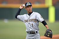 Shortstop Hoy Jun Park (1) of the Charleston RiverDogs warms up before a game against the Greenville Drive on Friday, July 28, 2017, at Fluor Field at the West End in Greenville, South Carolina. Charleston won, 6-1. (Tom Priddy/Four Seam Images)
