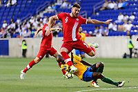 Harrison, NJ - Friday July 07, 2017: Lucas Cavallini, Kevin Rimane during a 2017 CONCACAF Gold Cup Group A match between the men's national teams of French Guiana (GUF) and Canada (CAN) at Red Bull Arena.