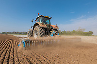 Power harrow cultivating ahead of potato planting - Lincolnshire, April