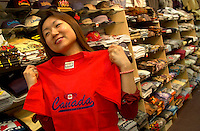 June 16 , 2002, Montreal, Quebec, Canada<br /> <br /> A Japanese tourist look at souvenir items in a Old Montreal shop, June 16 , 2002.<br /> <br /> Model released for all usages.<br /> <br /> Mandatory Credit: Photo by Pierre Roussel- Images Distribution. (©) Copyright 2002 by Pierre Roussel <br /> <br /> NOTE Nikon D-1 jpeg opened with Qimage icc profile, saved in Adobe 1998 RGB. Original size - uncropped TIFF file available on request.