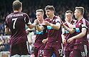 Hearts' Calum Paterson thanks Ryan Stevenson for the pass that led to him scoring their fifth goal.
