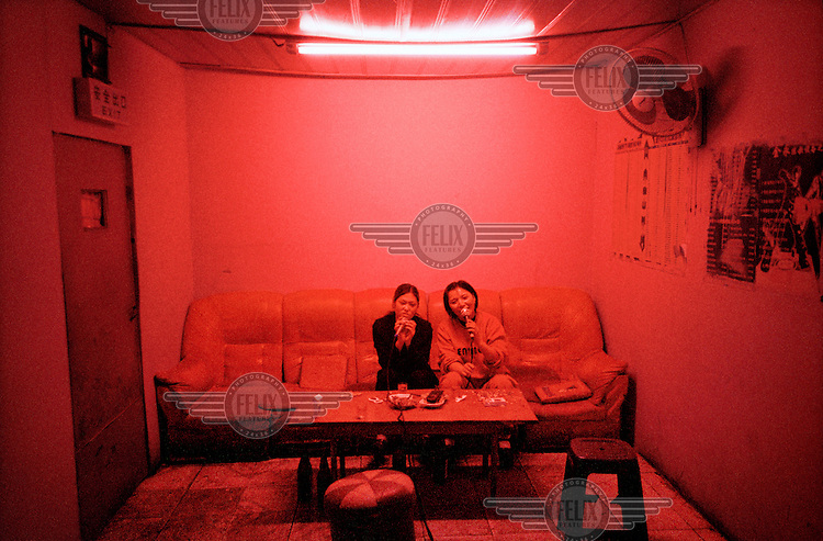 Karaoke hostesses in a bar on the Sino-Russian-North Korean border.