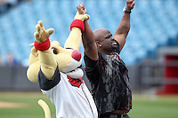 "Nashville Sounds mascot Ozzie with Dudley Boyz wrestler ""Brother Devon"" (aka Devon E. Hughes) talks with school kids before a game against the Omaha Storm Chasers at Greer Stadium on April 26, 2011 in Nashville, Tennessee.  The game was cancelled due to rain.  Photo By Mike Janes/Four Seam Images"