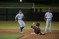 AZL Royals second baseman Kember Nacero (2) makes a throw to first base on a double play attempt during an Arizona League game against the AZL Giants Black at Scottsdale Stadium on August 7, 2018 in Scottsdale, Arizona. The AZL Giants Black defeated the AZL Royals by a score of 2-1. (Zachary Lucy/Four Seam Images)