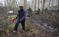 Pictured: Footballers in full gear walk through the muddy terrain. Tuesday 25 January 2011<br />