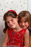 7 year old girl portrait with 5 year old sister vertical