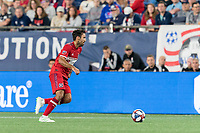 FOXBOROUGH, MA - AUGUST 25: Jonathan Bornstein #3 of Chicago Fire dribbles at midfield during a game between Chicago Fire and New England Revolution at Gillette Stadium on August 24, 2019 in Foxborough, Massachusetts.