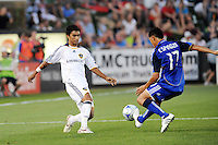 Roger Espinoza (blue) , A.J DeLaGraza..Kansas City Wizards tied 1-1 with L.A Galaxy at Community America BallPark, Kansas City, Kansas.