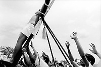 Philippines. Luzon island. San Fernando, Pampanga.70 km from Manila. Crucifixions at Easter on Good Friday. A man has been nailed to a cross . © 1999 Didier Ruef