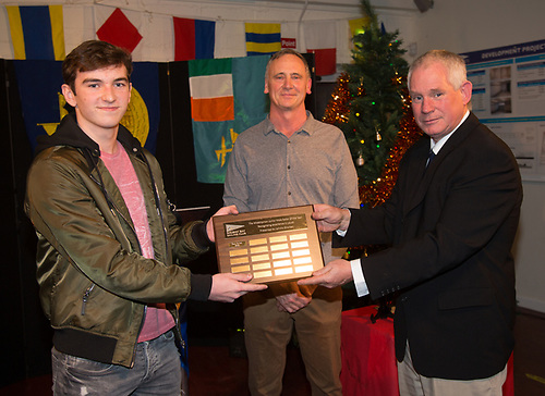 Rory Collins winner of the Junior Male Sailor awarded the MidShipMan award presented by Johnny Shorten Commodore and Pat Irwin Galway Bay Sailing Club