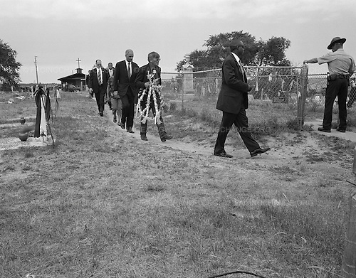 Wounded Knee, South Dakota<br /> July 28, 2011<br /> <br /> United States Attorney General Eric Holder visits the Wounded Knee mass grave with Pine Ridge Reservation officials to lay a wreath in memory of the dead.