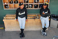 April 30, 2009: Manager Edgar Alfonzo, left, of the Savannah Sand Gnats, talks with coach Jose Carreno prior to a game at Fluor Field at the West End in Greenville, S.C. Photo by: Tom Priddy/Four Seam Images