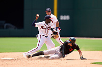 FCL Braves shortstop Francisco Floyd (4) turns a double play as Coby Mayo (2) slides in and second baseman Joseph Fernando (27) backs up the play during a game against the FCL Orioles Orange on July 22, 2021 at the CoolToday Park in North Port, Florida.  (Mike Janes/Four Seam Images)
