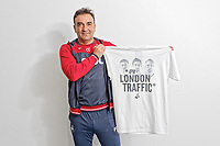 """Pictured: Manager Carlos Carvalhal holding one of the t-shirts. Tuesday 27 March 2018<br /> Re: New Swansea City FC t-shirts with messages like """"All The Meat on the Barbecue"""" and 4pm London Traffic"""" at the Fairwood Training Ground near Swansea, Wales, UK"""