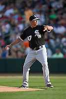 Chicago White Sox third base coach Joe McEwing (47) throws out the first pitch prior to the exhibition game against the Charlotte Knights at BB&T Ballpark on April 3, 2015 in Charlotte, North Carolina.  The Knights defeated the White Sox 10-2.  (Brian Westerholt/Four Seam Images)