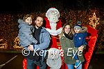 Weston Jaysen, Alekander and Elizebh Sokolowski visiting the Santa sleigh at Gallys on Saturday.