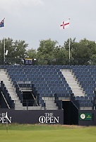 14th July 2021; The Royal St. George's Golf Club, Sandwich, Kent, England; The 149th Open Golf Championship, practice day; a St George's flag above the grandstand flutters in the breeze on the 18th hole