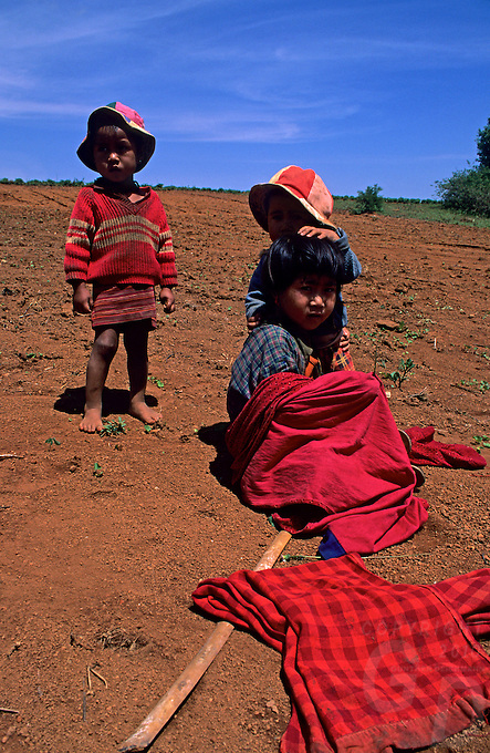 Images from the Book Journey Through Color and Time, Northern Burma, Myanmar, poor Farmers Children waiting for their parents who are working the fields