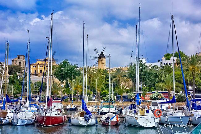 Windmills, dominating the high terrain of El Jonquet in Palma, viewed from the Real Club Nautico de Palma Marina (Royal Nautical Yacht Club), Palma de Mallorca