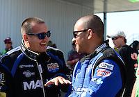 Sept. 23, 2012; Ennis, TX, USA: NHRA top fuel dragster driver Brandon Bernstein (left) with J.R. Todd during the Fall Nationals at the Texas Motorplex. Mandatory Credit: Mark J. Rebilas-
