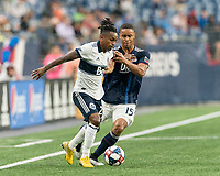 FOXBOROUGH, MA - JULY 17: Yordy Reyna #29 dribbles as Brandon Bye #15 defends during a game between Vancouver Whitecaps and New England Revolution at Gillette Stadium on July 17, 2019 in Foxborough, Massachusetts.