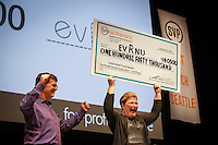 The SVP Fast Pitch Seattle competition held in McCaw Hall on Oct. 23, 2014. Will Poole, Social Technologist, SVP Seattle (left) and Stacy Flynn, CEO & Co-Founder, of Evrnu won First Place Investment Fund For-Profit $140,000.  Evrnu is a disruptive technology that recycles the $350B of cotton garment waste thrown away every year in the US. (photo by Gary Voth / vothphoto.com)