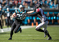 CHARLOTTE, NC - NOVEMBER 17: Christian McCaffrey #22 of the Carolina Panthers straight-arms Deion Jones #45 of the Atlanta Falcons during a run during a game between Atlanta Falcons and Carolina Panthers at Bank of America Stadium on November 17, 2019 in Charlotte, North Carolina.