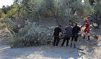 FAO JANET TOMLINSON, DAILY MAIL PICTURE DESK<br /> Pictured: Special forensics police officers move a tree after it was felled to make space for a further search by a disused building in a field in Kos, Greece. Saturday 01 October 2016<br /> Re: Police teams led by South Yorkshire Police, searching for missing toddler Ben Needham on the Greek island of Kos have moved to a new area in the field they are searching.<br /> Ben, from Sheffield, was 21 months old when he disappeared on 24 July 1991 during a family holiday.<br /> Digging has begun at a new site after a fresh line of inquiry suggested he could have been crushed by a digger.