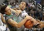 Green Valley's Brandon Hoisington fights for the ball against Hugh defenders during a semi-final game in the NIAA 4A State Basketball Championships between Hug and Green Valley high schools at Lawlor Events Center in Reno, Nev, on Thursday, Feb. 23, 2012. .Photo by Cathleen Allison