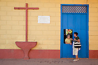 Cuba, Trinidad.  Doorway and Cross.  Street Scene.  The plaque on the wall announces that Alexander Humboldt, for whom the Humboldt current is named, stayed in the house in 1801.