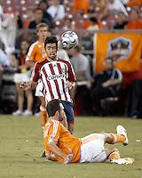 Houston Dynamo defender Ryan Cochrane (9) deflects the ball off the face of CD Chivas USA midfielder Paulo Nagamura (26).  Houston Dynamo defeated CD Chivas USA 4-0 at Robertson Stadium in Houston, TX on June 21, 2007.