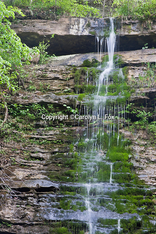 Water runs over the hill at Twin Falls In Afkansas.