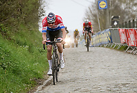 Mathieu Van der Poel (NED/Alpecin-Fenix)  making the decisive move up the Oude Kwaremont with Kasper Asgreen (DEN/Deceuninck - Quick Step) eventually catching on & Wout van Aert (BEL/Jumbo-Visma) dropping off...<br /> <br /> 105th Ronde van Vlaanderen 2021 (MEN1.UWT)<br /> <br /> 1 day race from Antwerp to Oudenaarde (BEL/264km) <br /> <br /> ©kramon