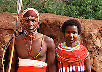 Portrait of a Masai couple in traditional attire. Kenya.