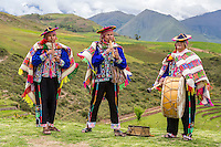Peru, Moray, Urubamba Valley.  Quechua Musicians at the Parador de Moray.  Foothills of the Andes in the Background.