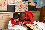 K-8 Parochial School Bronx New York Grade 3 mathematics lesson on measurement using rulers two boys working together horizontal