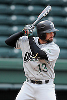 Third baseman AJ Mackey (13) of the USC Upstate Spartans bats in a game against the Furman University Paladins on Tuesday, March 4, 2013, at Fluor Field at the West End in Greenville, South Carolina. Furman won, 13-1. (Tom Priddy/Four Seam Images)