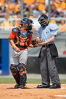 Greeneville Astros catcher Gabriel Bracamonte (18) gets a new baseball from home plate umpire Sam Dodson during the game against the Kingsport Mets at Hunter Wright Stadium on July 7, 2015 in Kingsport, Tennessee.  The Mets defeated the Astros 6-4. (Brian Westerholt/Four Seam Images)