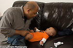 5 month old baby boy with father child care clothing diaper change happy interaction