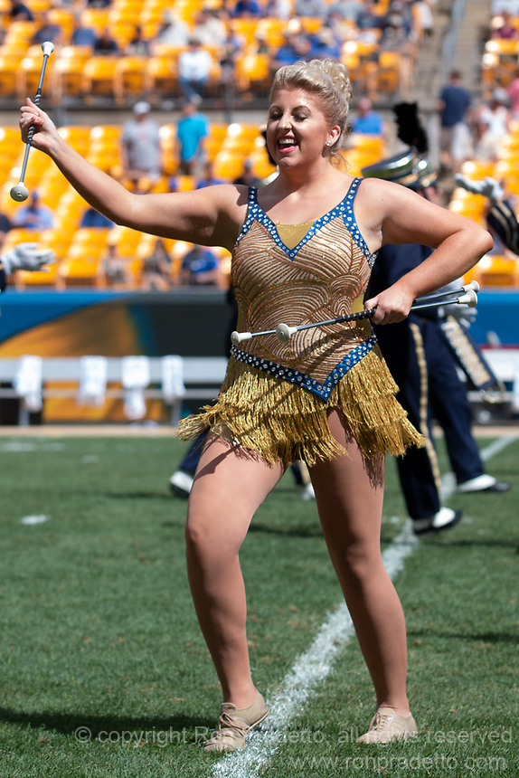 A Pitt Golden Girl majorette performs at halftime. The Pitt Panthers football team defeated the Georgia Tech Yellow Jackets 24-19 on September 15, 2018 at Heinz Field in Pittsburgh, Pennsylvania.