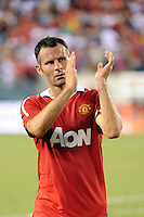 Ryan Giggs (11) of Manchester United salutes the fans after the game. Manchester United (EPL) defeated the Philadelphia Union (MLS) 1-0 during an international friendly at Lincoln Financial Field in Philadelphia, PA, on July 21, 2010.