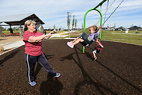 JoLynne Youngblood plays on Saturday May 1 2021 with her granddaughter, Palmer Walker, 2, at the new Shaw Family Park in northwest Springdale. The park includes three miles of walking trails, tennis courts, a splash pad, playgrounds and picnic pavilions. City officials dedicated the park with speeches and a ribbon cutting on May 1. <br />(NWA Democrat-Gazette/Flip Putthoff)