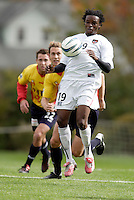 The MetroStars' Fabian Taylor looks to control the ball in front of  Kelly Gray of the Fire, and 2004 Hall of Fame inductee Eric Wynalda. The MetroStars defeated the Chicago Fire 2-0 during the inaugural Hall of Fame game on Monday October 11, 2004 at At-A-Glance Field at the National Soccer Hall of Fame and Museum, Oneonta, NY..