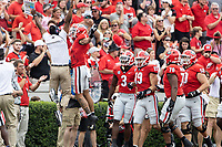ATHENS, GA - SEPTEMBER 11: Jermaine Burton #7  celebrates his touchdown with a member of the coaching staff during a game between University of Alabama Birmingham Blazers and University of Georgia Bulldogs at Sanford Stadium on September 11, 2021 in Athens, Georgia.